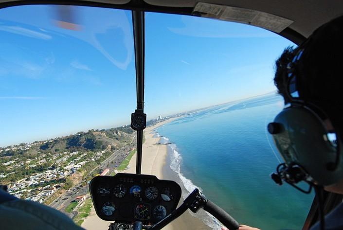 cockpit view of helicopter flight along la coastline toward santa monica