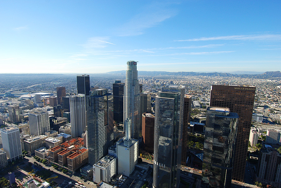 Los Angeles helicopter tour over Downtown LA skyscrapers looking West
